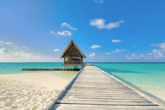 Jetty. Maldives, jetty leading to dive center overlooking sea royalty free stock image