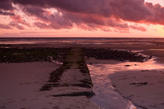 Jetty. Stones jetty on beautiful Rumpside beach in Great Britain Stock Image