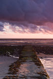 Jetty. Stones jetty on beautiful Rumpside beach in Great Britain Royalty Free Stock Images