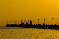 Jetty against beautiful at sunrise. Royalty Free Stock Images