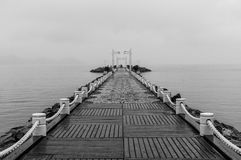 Jetty in Balneario Camboriu. A black and white picture of a jetty on a cloudy day in the touristic city of Balneario Camboriu, Brazil Royalty Free Stock Photo