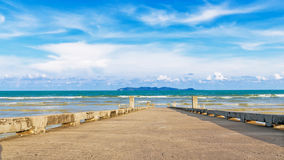 Jetty at beach with blue sky Royalty Free Stock Photos