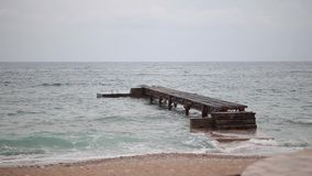 Jetty on the beach in Budva. Near the old town stock footage