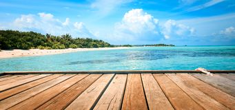 Jetty, beach and jungle - vacation background Royalty Free Stock Photos