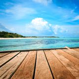 Jetty, beach and jungle - vacation background Stock Image