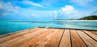 Jetty, beach and jungle - vacation background Royalty Free Stock Image
