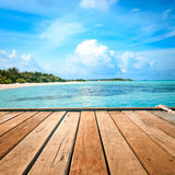 Jetty, beach and jungle - vacation background Royalty Free Stock Photo