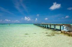 Jetty on a beach in Moorea. Tahiti royalty free stock photography