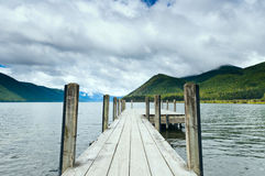 Jetty of a beautiful lake Royalty Free Stock Photo