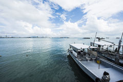 Jetty with boat daytime Stock Photography