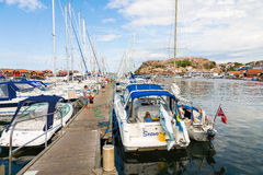 Jetty with boats in the coastal village Royalty Free Stock Image