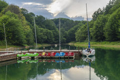 Jetty and boats. Jetty and empty sailing and pedal boats on the lake at Solina , Poland Royalty Free Stock Images