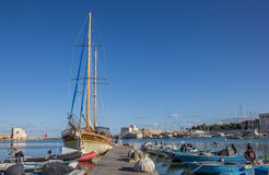 Jetty with boats in the harbor of Trani Royalty Free Stock Photo