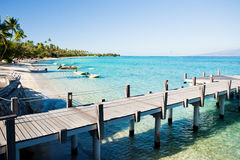 Jetty and boats on tropical beach Stock Photography