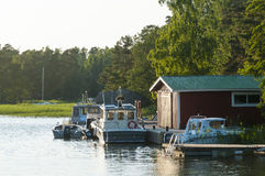 Jetty with boatshed and moored leisureboats Finland Stock Image