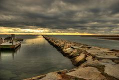 Jetty in Cape Cod. A long jetty under cloudy skies in Cape Cod, Massachusetts Stock Photography