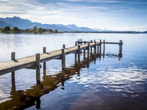 Jetty at the Chiemsee. In Germany with blue sky Royalty Free Stock Photography