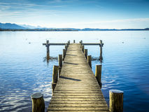 Jetty at the Chiemsee. In Germany with blue sky Royalty Free Stock Photos