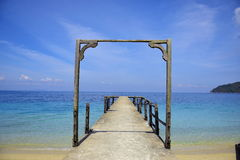 Jetty. With clear blue sky and crystal clear sea Stock Photo