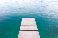 Jetty with clear blue water Royalty Free Stock Images