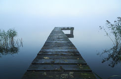 Jetty. Close up of old, wooden jetty in the autumn fog Stock Image
