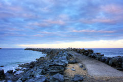 Jetty and Clouds Stock Images