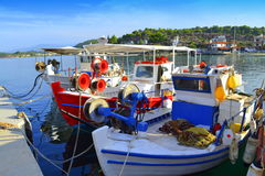 Jetty colorful fishermen boats Greece Stock Photo