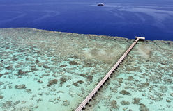 Jetty on a coral reef Stock Image