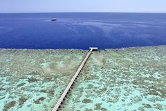 Jetty on a coral reef Stock Photo