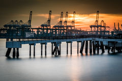Jetty and Cranes Stock Images