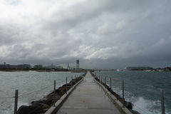 Jetty by cruise ship dock, Florida. Jetty by a cruise ship dock on a stormy day Stock Photos
