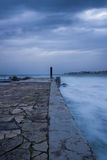 Jetty. Detail from a The Jetty in a long exposure photo. In the Portuguese coastline Royalty Free Stock Images