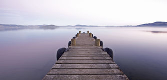 Jetty at dusk. Jetty on lake at dusk Stock Photography