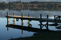 Jetty at dusk Stock Photos