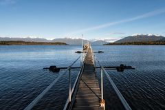 Jetty at Te Anau Downs in Southland, South Island, New Zealand. A jetty by the eastern shore of Lake Te Anau at Te Anau Downs during cold winter morning in 2016 Royalty Free Stock Photography
