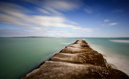 Jetty at edge of tranquil sea Stock Photos