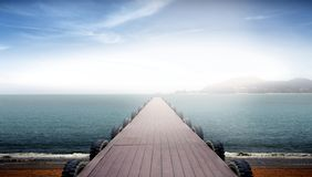 Jetty facing sea view during sunrise Royalty Free Stock Image