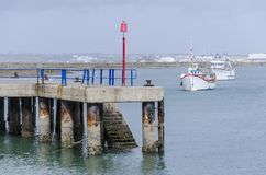 Jetty of fishing boats in the sea. On the Spanish coast Royalty Free Stock Photo