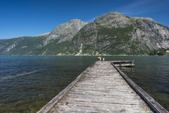 Jetty fjord. A jetty leading to boat on the Eidfjord fjord in summer Stock Photo