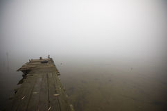 Jetty in the fog Stock Image