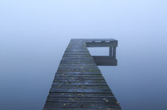 Jetty in the fog Stock Images