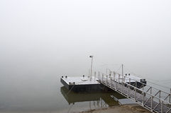 Jetty at foggy morning slant Royalty Free Stock Images