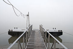 Jetty at foggy morning Stock Photo