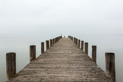 Jetty in foggy weather (horizontal) Royalty Free Stock Image