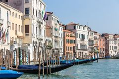 Jetty with gondolas on a canal in Venice, Italy royalty free stock photography