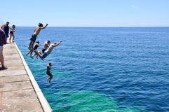 Jetty Jumps into Turquoise Waters Stock Image