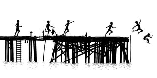 Jetty kids. Editable vector silhouette of children jumping off a wooden jetty Royalty Free Stock Photo