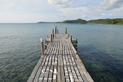 Wooden deck extend out of the sea Stock Photo