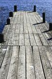 Jetty on a lake. Wooden jetty on a lake Royalty Free Stock Photo
