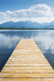 Jetty with lake and alps Royalty Free Stock Image